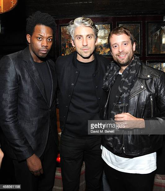 Adrien Sauvage George Lamb and PA attends Adrian Sauvage's 'This Is Not A Party' on November 6 2014 in London England