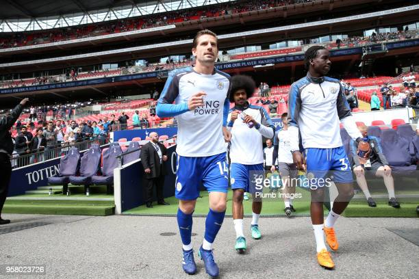 Adrien Silva and Fousseni Diabate of Leicester City head out to warm up at Wembley Stadium ahead of the Premier League match between Tottenham...