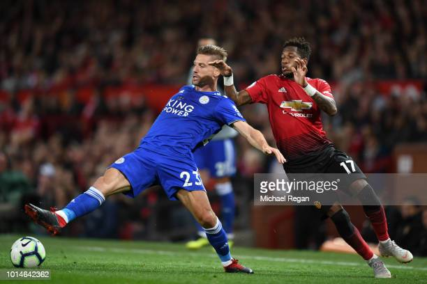 Adrien Silva of Leicester City battles for possession with Fred of Manchester United during the Premier League match between Manchester United and...