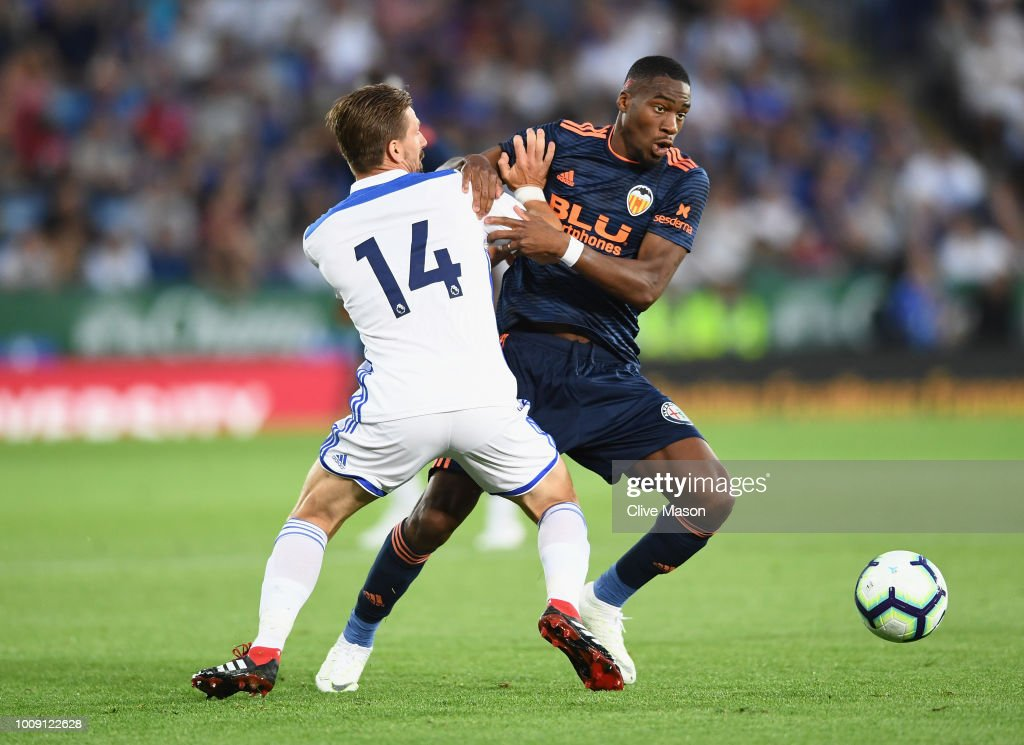 Adrien Silva of Leicester City challenges Geoffrey Kondogbia of Valencia during the pre-season friendly match between Leicester City and Valencia at The King Power Stadium on August 1, 2018 in Leicester, England.