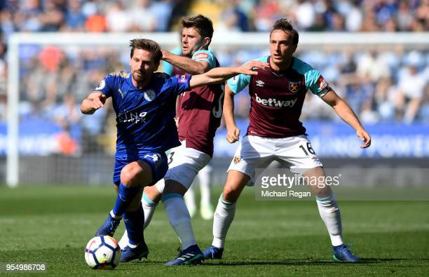 Adrien Silva of Leicester City controls the ball as Mark Noble of West Ham United and Aaron Cresswell of West Ham United looks on during the Premier...