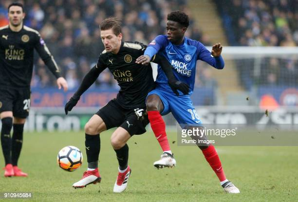 Adrien Silva of Leicester City in action with Leo De Silva Lopes of Peterborough United during The Emirates FA Cup Fourth Round tie between...