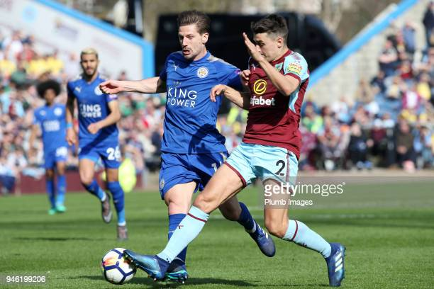 Adrien Silva of Leicester City in action with Matthew Lowton of Burnley during the Premier League match between Burnley and Leicester City at Turf...