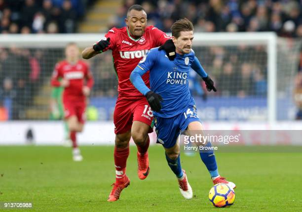 Adrien Silva of Leicester City is tackled by Jordan Ayew of Swansea City during the Premier League match between Leicester City and Swansea City at...