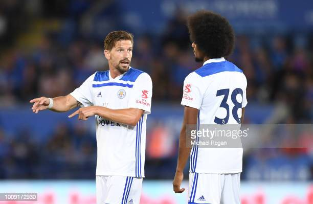 Adrien Silva of Leicester speaks to team mate Hamza Choudhury during the preseason friendly match between Leicester City and Valencia at The King...
