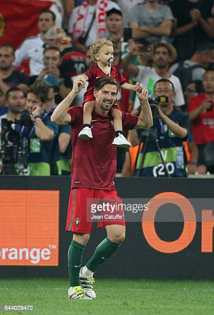 Adrien Silva of Portugal and his son Santiago Silva celebrate the victory following UEFA Euro 2016 quarter final match between Poland and Portugal at...