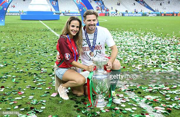 Adrien Silva of Portugal and his wife pose with the trophy following the UEFA Euro 2016 final match between Portugal and France at Stade de France on...
