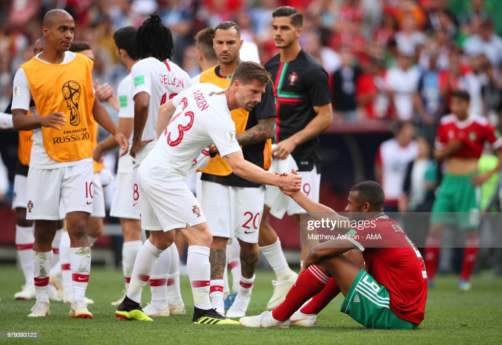 Adrien Silva of Portugal consoles Ayoub El Kaabi of Morocco at the end of the 2018 FIFA World Cup Russia group B match between Portugal and Morocco at Luzhniki Stadium on June 20, 2018 in Moscow, Russia.