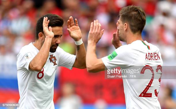 Adrien Silva of Portugal gets on the pitch for team mate Joao Moutinho during the 2018 FIFA World Cup Russia group B match between Portugal and...