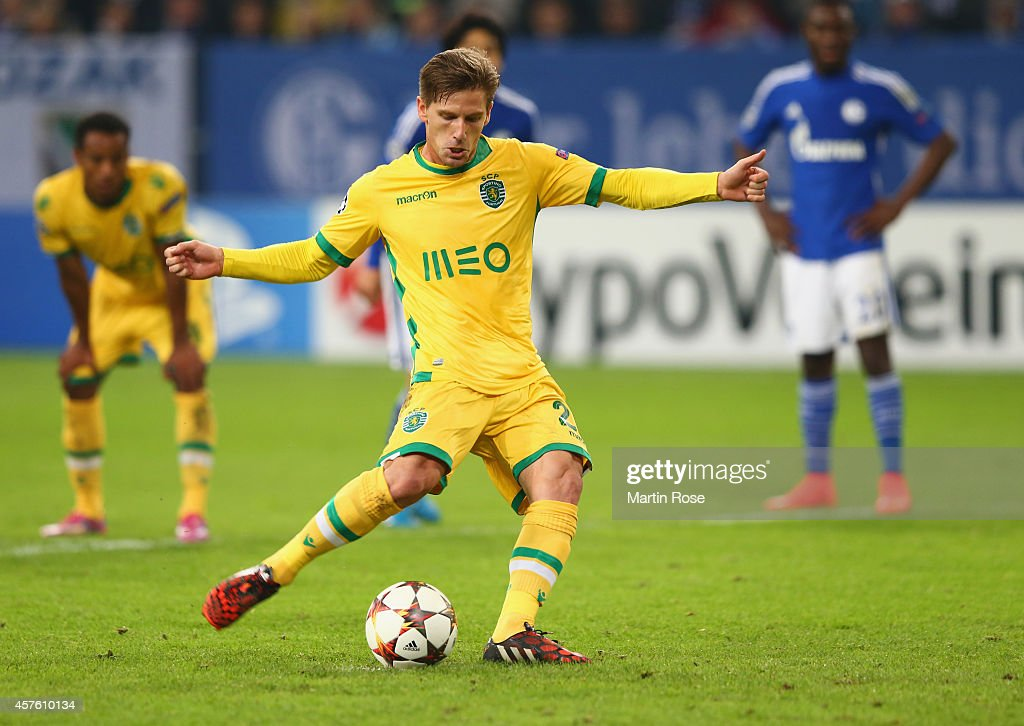 Adrien Silva of Sporting Lisbon scores their second goal from the penalty spot during the UEFA Champions League Group G match between FC Schalke 04 and Sporting Clube de Portugal at Veltins Arena on October 21, 2014 in Gelsenkirchen, Germany.