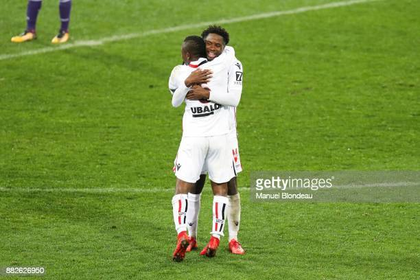 Adrien Tameze and Jean Michael Seri of Nice celebrate victory during the Ligue 1 match between Toulouse and OGC Nice at Stadium Municipal on November...