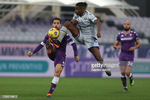 Adrien Tameze of Hellas Verona FC in action against Giacomo Bonaventura of ACF Fiorentina during the Serie A match between ACF Fiorentina and Hellas...