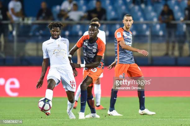 Adrien Tameze of Nice and Junior Sambia of Montpellier during the Ligue 1 match between Montpellier and Nice at Stade de la Mosson on September 22...