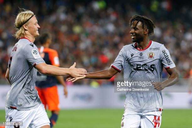 Adrien Tameze of OGC Nice celebrates his goal with Kasper Dolberg Rasmussen of OGC Nice during the Ligue 1 match between Montpellier HSC and OGC Nice...