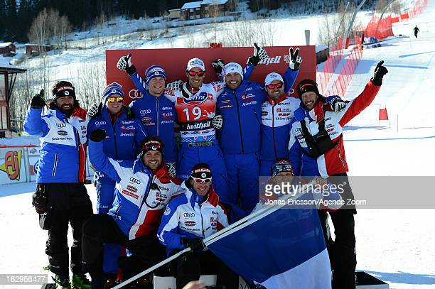 Adrien Theaux of France takes 1st place and celebrates with teammates and coaches during the Audi FIS Alpine Ski World Cup Men's Downhill on March 2...