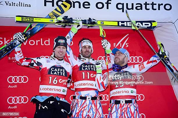 Adrien Theaux of France takes 1st place Hannes Reichelt of Austria takes 2nd place David Poisson of France takes 3rd place during the Audi FIS Alpine...