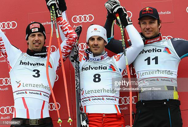 Adrien Theaux of France takes 1st place Joachim Puchner of Austria takes 2nd place Aksel Lund Svindal of Norway takes 3rd place during the Audi FIS...