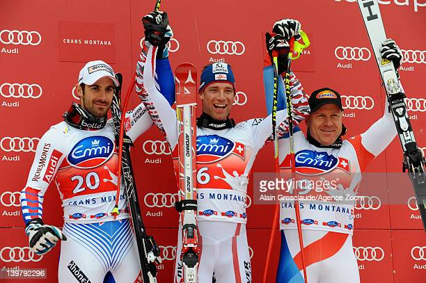 Adrien Theaux of France takes 2nd place Benjamin Raich of Austria takes 1st place and Didier Cuche of Switzerland takes 3rd place during the Audi FIS...