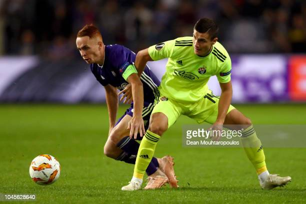 Adrien Trebel of RSC Anderlecht battles for possession with Amer Gojak of Dinamo Zagreb during the UEFA Europa League Group D match between RSC...