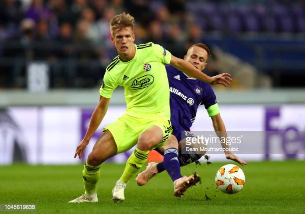 Adrien Trebel of RSC Anderlecht tackles Dani Olmo of Dinamo Zagreb during the UEFA Europa League Group D match between RSC Anderlecht and Dinamo...