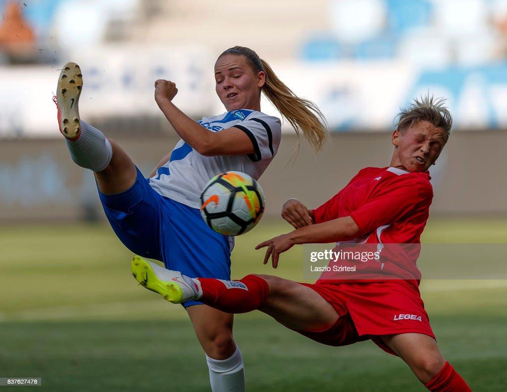 Adrienn Olah (L) of MTK Hungaria FC shoots on goal next to Donjeta Haxha (R) of WFC Hajvalia during the UEFA Women's Champions League Qualifying match between MTK Hungaria FC and WFC Hajvalia at Nandor Hidegkuti Stadium on August 22, 2017 in Budapest, Hungary.