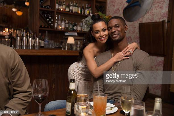 Adrienne and Chris Bosh strike a pose during Dwyane Wade Farewell Dinner at Cypress Tavern on September 17 2016 in Miami Florida Adrienne Bosh Chris...