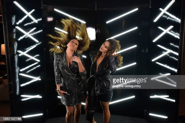 Adrienne Bailon and Amber Ridinger attend the Lumiere De Vie Hommes Launch Event Aboard Superyacht Utopia IV on October 13 2018 in New York City