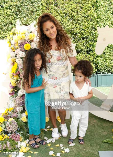Adrienne Bailon and her nieces attend a BackToSchool block party at The Park at The Grove on August 25 2018 in Los Angeles California