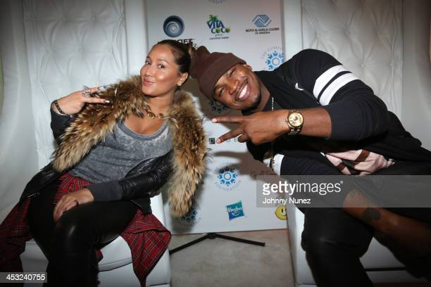 Adrienne Bailon and NeYo attend the Compound Foundation Giving Tour 2013 at the Boys Girls Club of Harlem on December 2 2013 in New York City