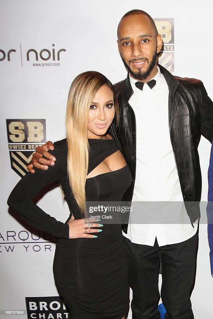 Adrienne Bailon and Swizz Beatz attend the Bronx Charter School for the Arts 2013 art auction at Marquee on May 14, 2013 in New York City.