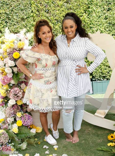Adrienne Bailon and Tia Mowry attend a BackToSchool block party at The Park at The Grove on August 25 2018 in Los Angeles California