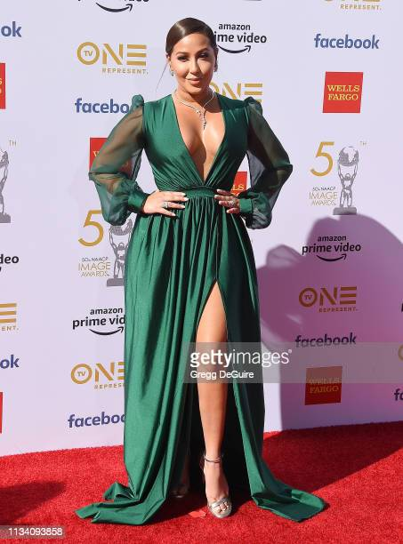 Adrienne Bailon arrives at the 50th NAACP Image Awards at Dolby Theatre on March 30 2019 in Hollywood California