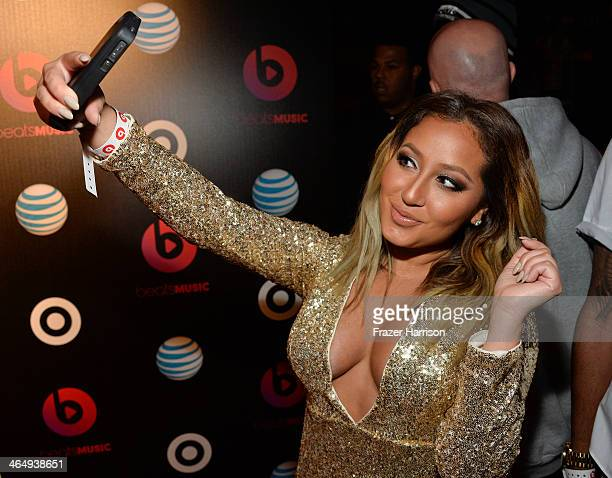 Adrienne Bailon attends Beats Music Launch Party At Belasco Theatre at Belasco Theatre on January 24 2014 in Los Angeles California