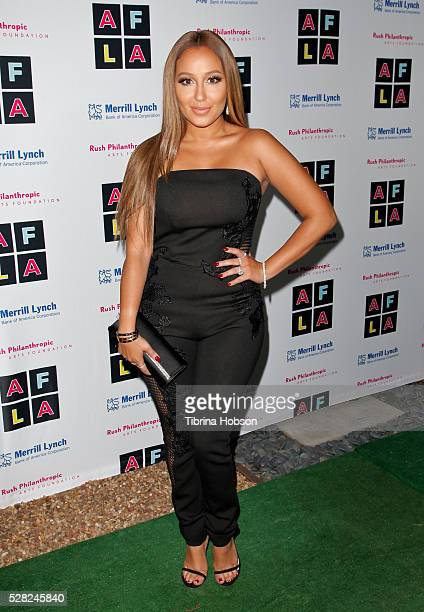 Adrienne Bailon attends Russell Simmons' Rush Philanthropic Arts Foundation's Inaugural Art For Life Celebration on May 3 2016 in West Hollywood...