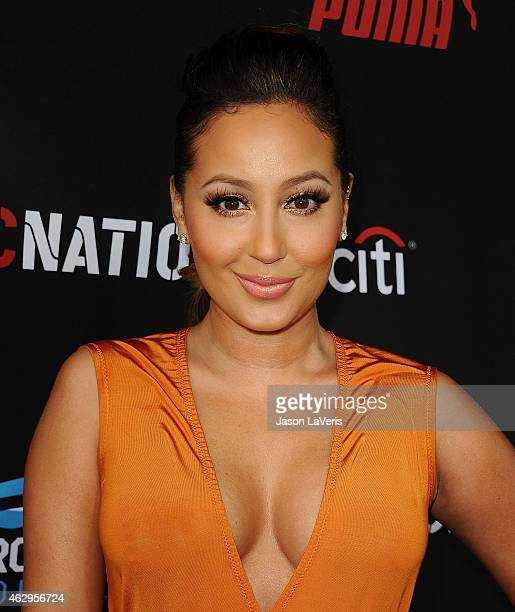 Adrienne Bailon attends the Roc Nation Grammy brunch on February 7 2015 in Beverly Hills California