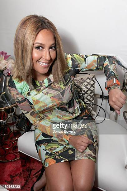Adrienne Bailon attends the Samsung Galaxy Blue Room during MercedesBenz Fashion Week Spring 2014 at Lincoln Center on September 9 2013 in New York...