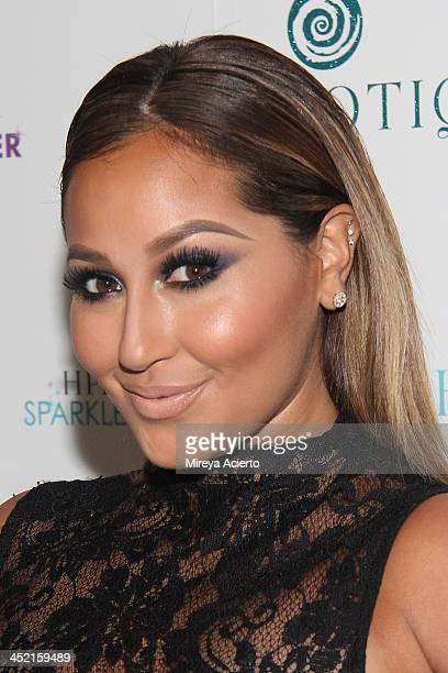 Adrienne Bailon attends the 'Sparkle Louder' launch event on November 26 2013 in New York City