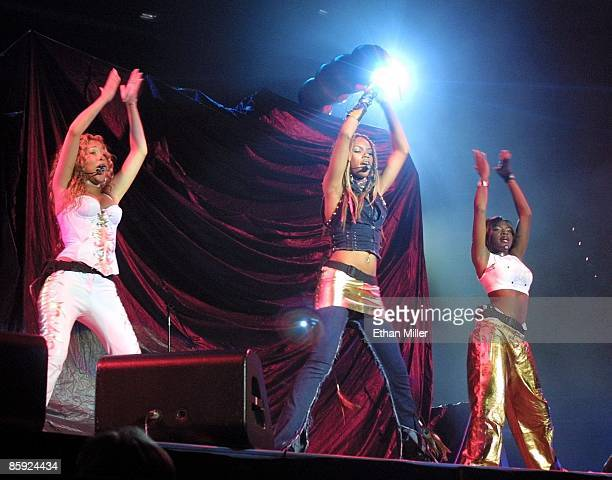 Adrienne Bailon Kiely Williams and Naturi Naughton of 3LW perform during a soldout show at the Mandalay Bay Events Center during MTV's TRL tour...