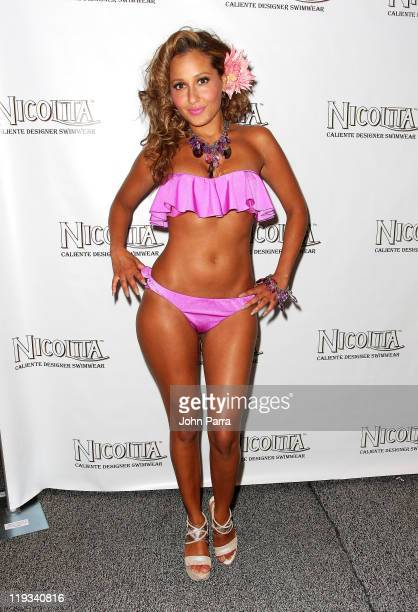 Adrienne Bailon poses backstage at the Nicolita show during MerecedesBenz Fashion Week Swim 2012 at The Raleigh on July 18 2011 in Miami Beach United...