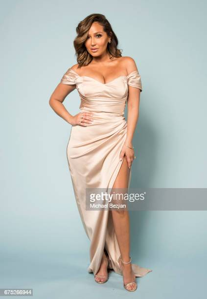 Adrienne Bailon poses for a portrait at 'Portraits by The Artists Project Sponsored by Foster Grant on' during the 44th Daytime Emmy Awards on April...
