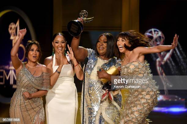 Adrienne Bailon Tamera Mowry Loni Love and Jeannie Mai winners of Outstanding Entertainment Talk Show Host for 'The Real' accept award onstage during...