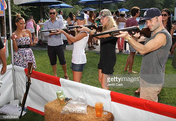 Adrienne Bailon Tinsley Mortimer Dabney Mercer and Eugene Remm of EMM Group play the Shotgun Challenge at the Absolut Brooklyn BBQ at The Estate on...