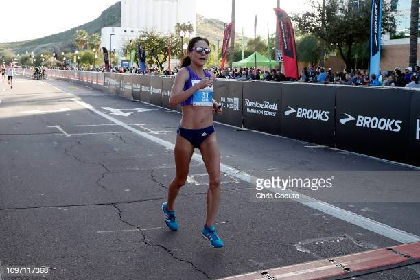 Adrienne Barry crosses the finish line of the Humana Rock 'n' Roll 1/2 Marathon on January 20 2019 in Tempe Arizona