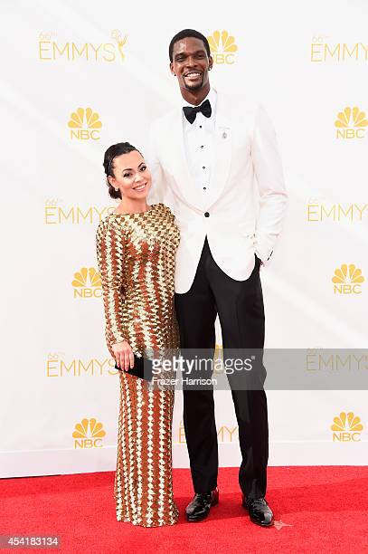 Adrienne Bosh and basketball player Chris Bosh attend the 66th Annual Primetime Emmy Awards held at Nokia Theatre LA Live on August 25 2014 in Los...