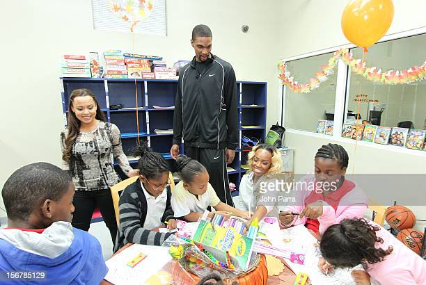 Adrienne Bosh and Chris Bosh attend the 2nd year with the Chapman Partnership to help feed the local families of Miami this Thanksgiving at Chapman...