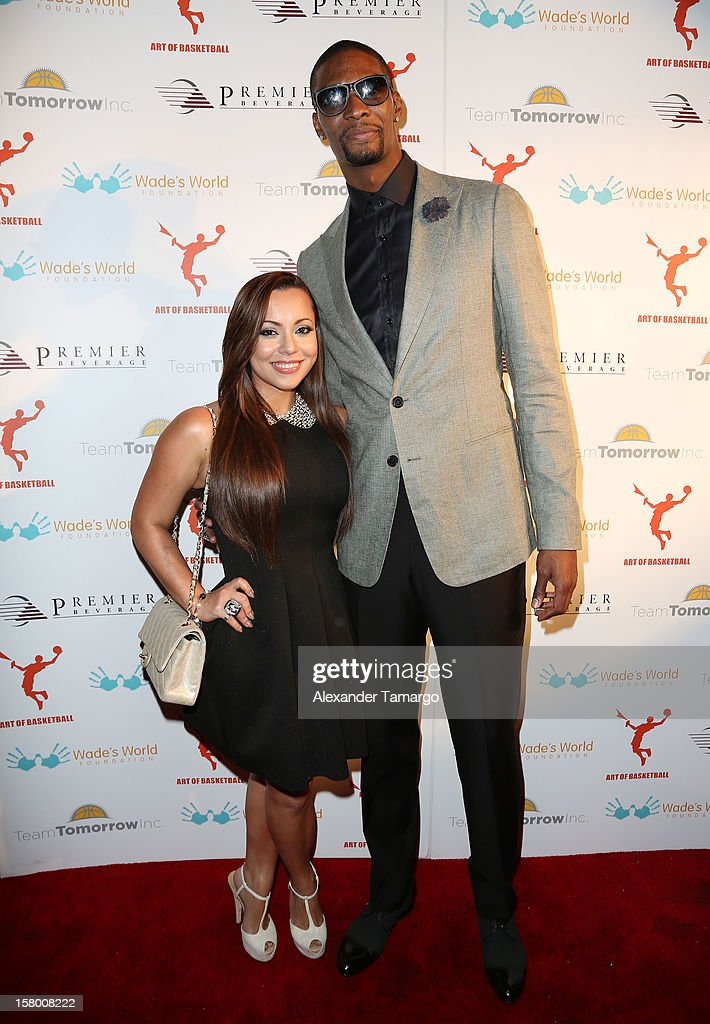 Adrienne Bosh and Chris Bosh make an appearance as Premier Beverage Hosts Art Of Basketball: Heat Wave With Dwyane Wade & Chris Bosh on December 7, 2012 in Miami, Florida.