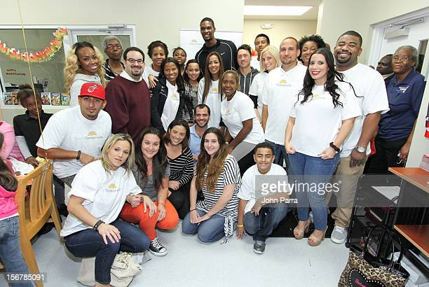Adrienne Bosh and Chris Bosh with all the volunteers on the 2nd year with the Chapman Partnership to help feed the local families of Miami this...