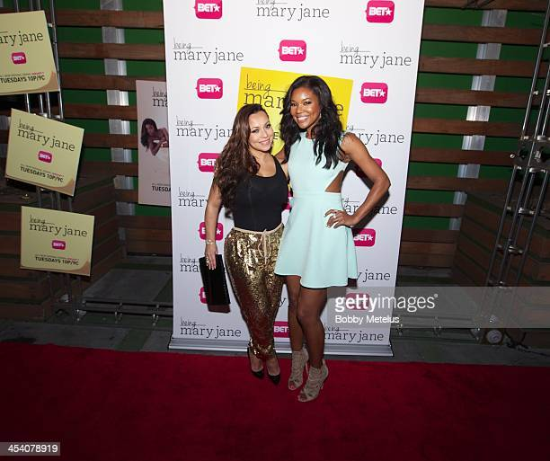 Adrienne Bosh and Gabrielle Union attends BET 'Being Mary Jane' Art Basel Celebration at Mokai lounge on December 6 2013 in Miami Beach Florida