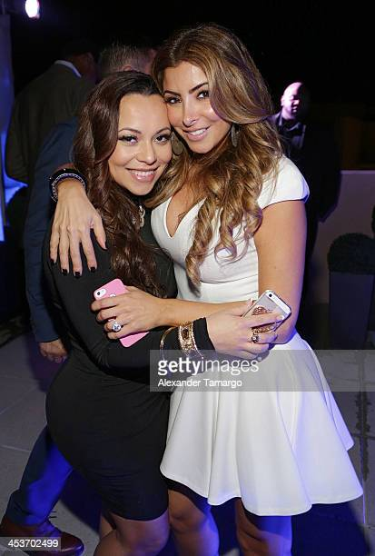 Adrienne Bosh and Larsa Pippen pose at the Haute Living OMEGA Dark Side of the Moon Watch event hosted by Larsa and Scottie Pippen on December 4 2013...