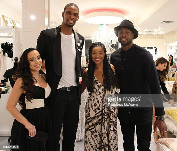 Adrienne Bosh Chris Bosh Gabrielle Union and Dwyane Wade attend Sparkle And Shine Grand Opening on November 9 2015 in Miami Beach Florida